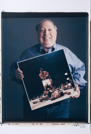 Neil Leifer with his photo in the book by Tim Mantoani